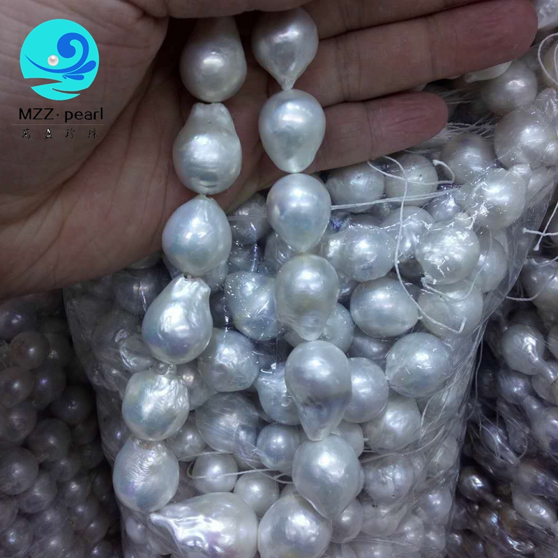 Lustrous semi baroque irregular pearl strands white color real freshwater pearls 12x15mm edison drop shaped pearl strands