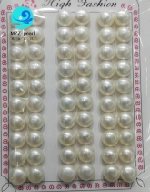 loose white button pearls